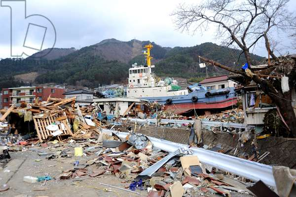 A tug boat rests upright among the debris in Ofunato Japan March 15 2011 four days after the 9.0 magnitude earthquake and tsunami of March 11.,