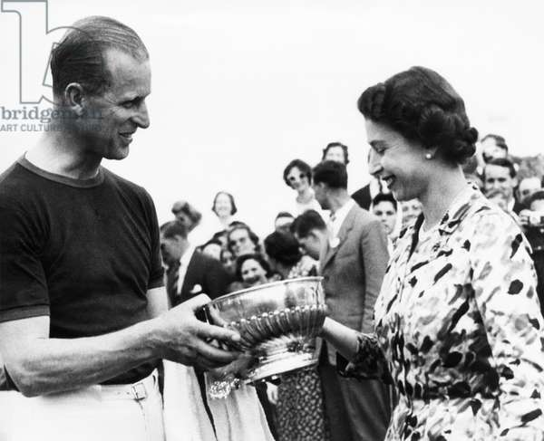 British Royalty. Duke of Edinburgh Prince Philip being presented a winning polo trophy by Queen Elizabeth II, Windsor Great Park, Windsor, England, 1961