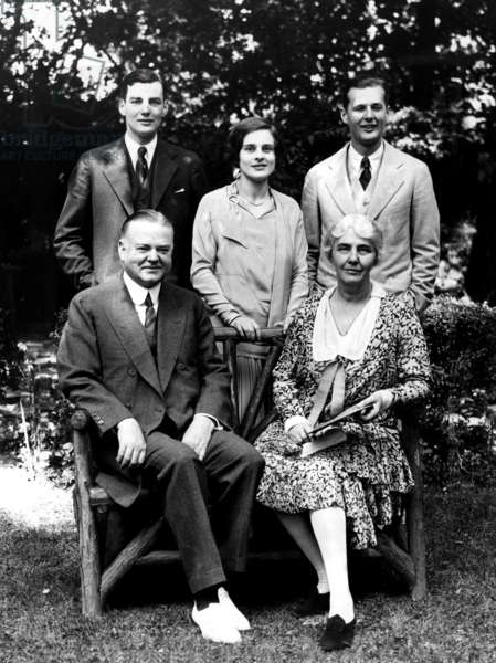 Herbert Hoover with his wife and family on the grounds of his home. Back row: Herbert Hoover jr, his wife Margaret and Allan Hoover. In front: Herbert Hoover and Lou Henry Hoover. ca 1928.