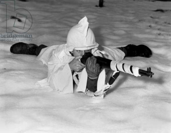 U.S. technical sergeant in the new snow cape used by infantrymen in snow-covered areas in Belgium. Dec. 12, 1944 through Jan.25, 1945. Battle of the Bulge, World War 2