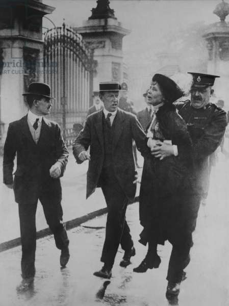 British suffragette Emmeline Pankhurst arrested and carried away by a policeman for leading suffragettes attempt to present a petition to King George V at Buckingham Palace. June 2, 1914