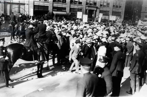 Mounted police forcing their horses to disperse the great horde of socialists at Union Square. They were attending a mass meeting held to protest the death sentences of Nicola Sacco and Bartolomeo Vanzetti. NYC. August 13, 1927.