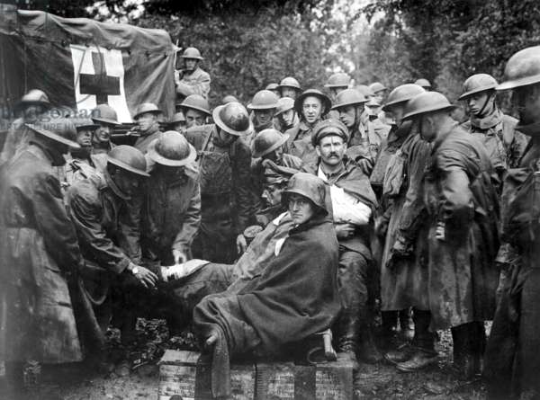 Wounded German prisoners receiving medical attention at first-aid station of 103rd and 104th Ambulance Companies. World War I. Sept. 1918