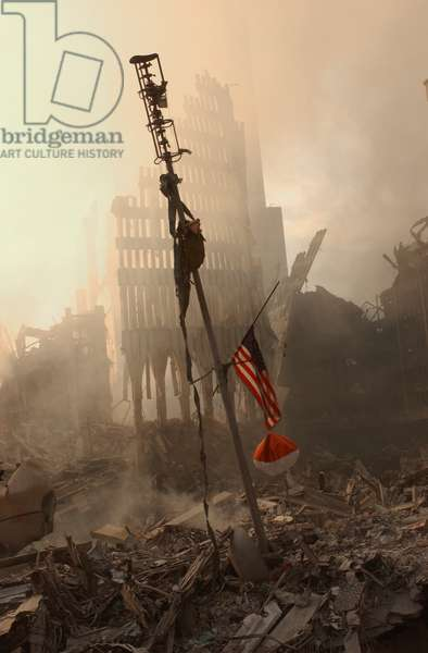 The airplane alert antenna sits amidst the rubble of the World Trade Center, Sept 13, 2001. This was one of the collision avoidance devices of the Twin Towers used to warn off airplanes. In the background are the remains of WTC 1. New York City, after September 11, 2001 terrorist attacks