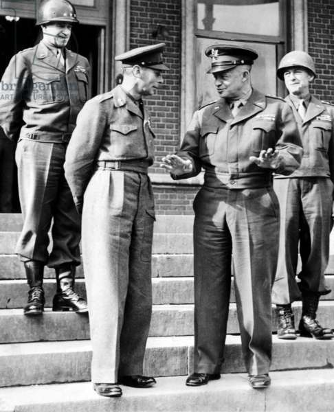 Lt. General Omar N. Bradley, King George VI, General Dwight D. Eisenhower and Lt. General Courtney Hodges, during the king's tour of the battlefronts in France
