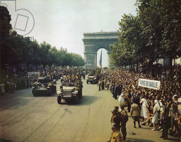 Victory parade on the Champs Elysees. Crowds cheer the Free French Forces and hold a sign 'Vive De Gaulle.' Paris August 26 1944 the day after Paris was liberated
