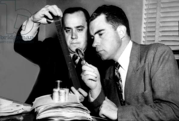 Richard Nixon and Rob Stipling of HUAC looking at microfilm (possibly in Alger Hiss case)