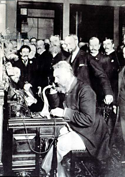 "ALEXANDER GRAHAM BELL, demonstrating how to make a phone call in New York, March 12, 1876. Bell is talking to Thomas Watson & says, ""Mr. Watson -- Come here -- I want to see you."""