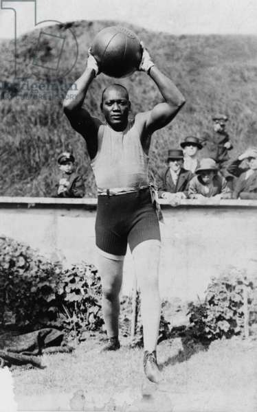 Jack Johnson (1878-1946) the first African American to win the Heavyweight Championship training with a medicine ball, 1910