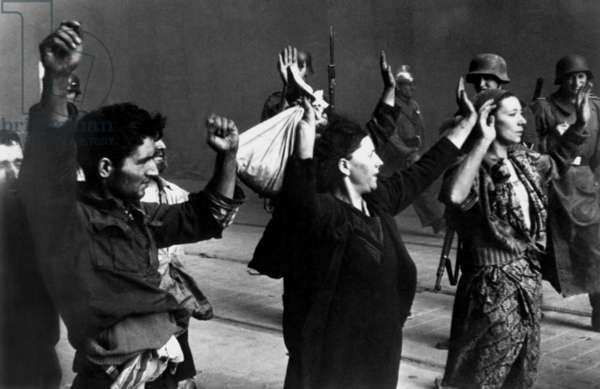 Polish Jews under arrest during the Warsaw Ghetto Uprising, April 19-May 16, 1943. Photo from the report of SS officer Jürgen Stroop to Heinrich Himmler was captioned, 'These bandits resisted by force of arms'. World War 2