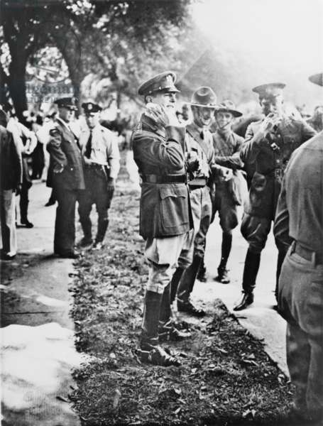 General Douglas MacArthur with his staff officer, Col. Dwight D. Eisenhower, stand among troops in Anacostia Flats during the U.S. Army action to break up the Bonus Marcher's encampment. Washington, D.C. July 1932
