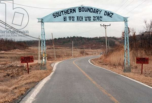 Road sign near the southern boundary of the De-Militarized Zone between North and South Korea. Mar. 28 1984