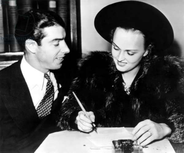 Joe DiMaggio and Dorothy Arnold as they file their intent to wed application. November 10, 1939
