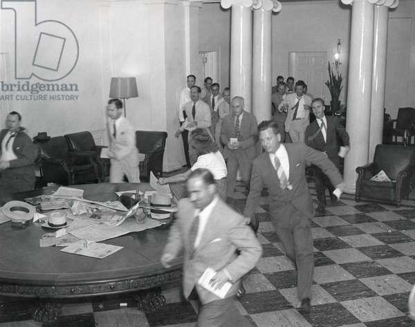 Reporters running through the White House after the announcement of Japan's surrender, ending WW2. August 14, 1945.