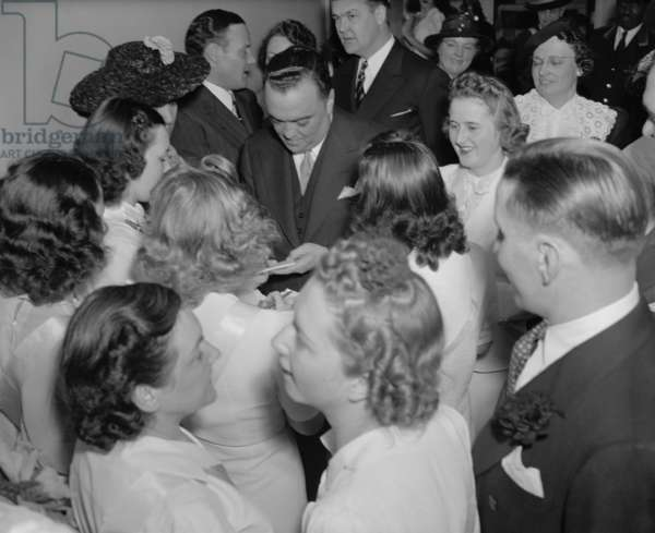 FBI Director J. Edgar Hoover surrounded by female admirers, c. 1940