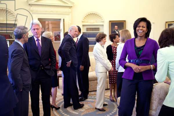 Michelle Obama laughs with guests in the Oval Office who include Bill Clinton Edward M. Kennedy Rosalynn Carter and VP Joe Biden. President Barack Obama is in the background. April 21 2009.,