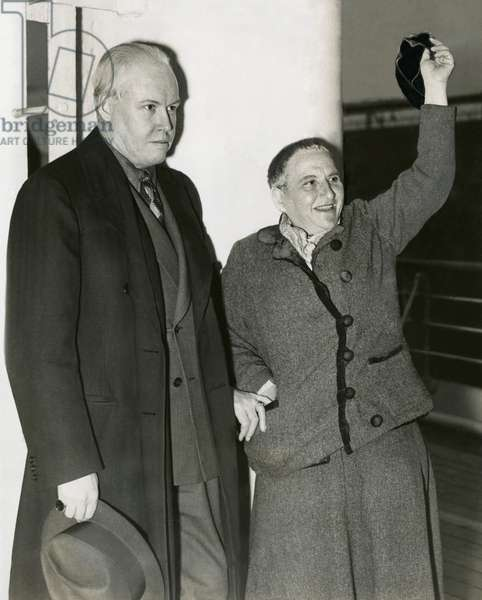Photographer Carl Van Vechten with Gertrude Stein as she waves her hat from S.S. Champlain. May 4, 1935. Stein had been part of the expatriate art community is Paris for decades. In 1933 she published a best selling memoir, 'The Autobiography of Alice B. Toklas,' written in the voice of Toklas, her life partner