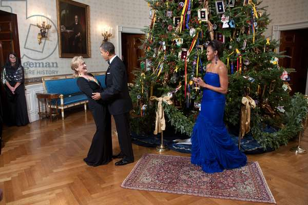 President Barack Obama and First Lady Michelle Obama welcome Meryl Streep to the White House in Washington for an evening in her honor on December 4, 2011