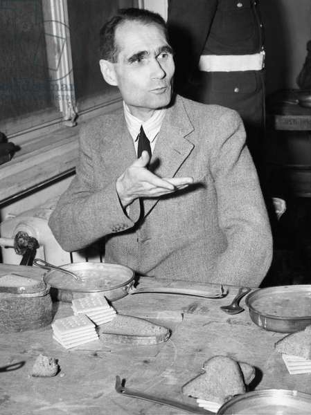 Nazi war criminal Rudolph Hess eating between sessions at the Nuremberg trials, 1945