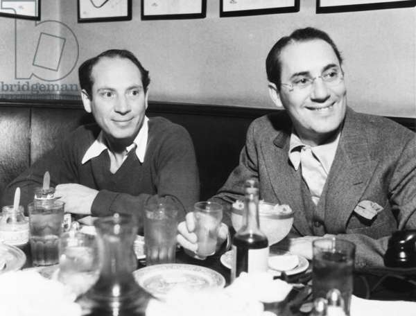 Chico (left) and Groucho Marx at lunch in the famous Brown Derby Restaurant in Hollywood. Feb. 16, 1933