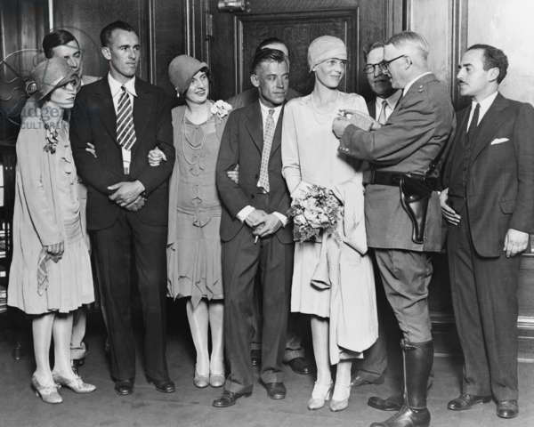 Chicago Chief of Police Michael Hughes pinning a star on Amelia Earhart on July 19, 1928. Left to right: Mrs. Stultz, Lou Gordon, Ann Bruce, Mr. Stultz, Amelia Earhart, Chief Hughes, and Acting Mayor William D. Saltiel