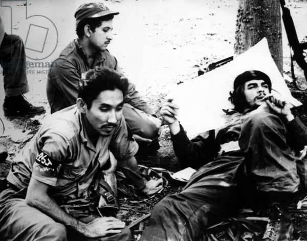 Ernesto 'Che' Guevara (at right) shown with followers just after they claimed capture of Fomento during Castro campaign against the Batista regime in Cuba, December, 1958