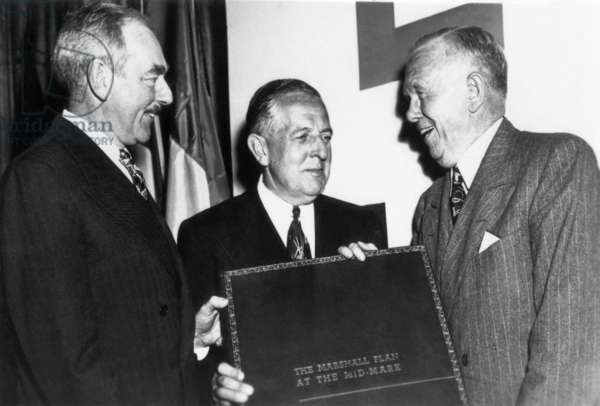 THE AMERICAN PARADE, from left: Secretary of State Dean Acheson and Administrator Paul Hoffman present a bound report on the 'Marshall Plan' for European recovery to George Marshall on its second anniversary in 1950, 'The General' (aired December 5, 1974), 1974