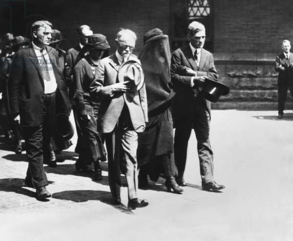 Mourners at President Warren Harding's funeral in Washington, D.C. August 7-8, 1923. Leading the group is the President's father, George Tryon Harding, Sr. (center, hat over heart) and the veiled widow, Florence Harding