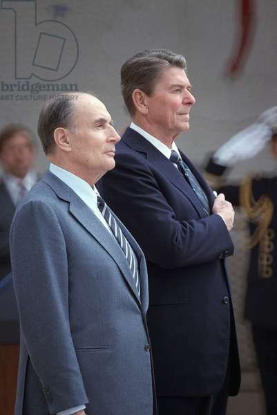 President Reagan and French President Francois Mitterrand attend a wreath-laying ceremony at Omaha Beach on the 40th anniversary of D-day the invasion of Europe. June 2 1984