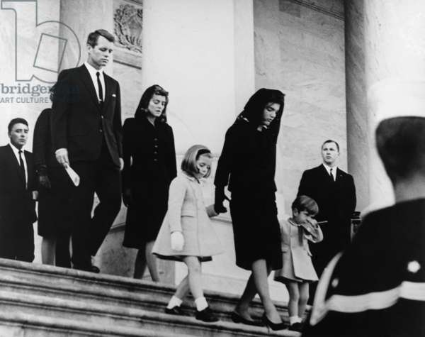 President Kennedy's family leaves the Capitol after a funeral ceremony. Caroline Kennedy, Jacqueline Kennedy, John F. Kennedy, Jr., followed by Robert Kennedy, Jean Kennedy Smith and Peter Lawford. United States Capitol, East Front, Washington, D.C. Nov. 24, 1963