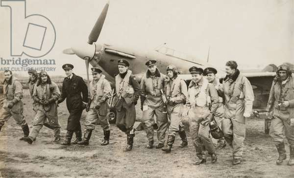 A Hawker Hurricane and 12 U.S. volunteers of Eagle Squadron in the R.A.F. prior to America's entry into World War II. in England, 1940. 244 Americans served with the three Eagle Squadrons in the first years of World War II