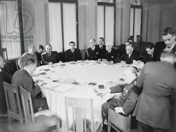 President Franklin D. Roosevelt, Prime Minister Winston Churchill and Marshal Joseph Stalin are shown with others around the conference table at Yalta, Crimea, in the Soviet Union