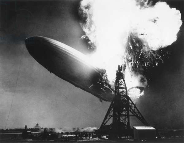 The German passenger airship Hindenburg seconds after catching fire, May 6, 1937. At 200 feet above the ground, flames erupt on top and in the back of the ship. It descended as it burned, reaching the ground as a metal skeleton after the fabric covering burned away in less than 30 seconds