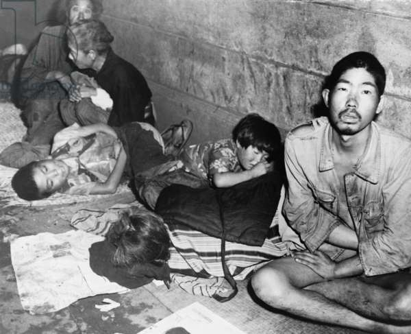 In Tokyo, months after Japan's World War II surrender, homeless Japanese families huddled in subway stations to sleep. October 20, 1945