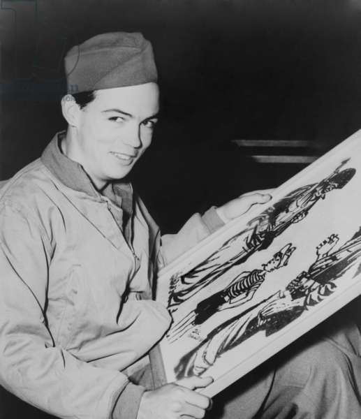 Bill Mauldin, American World War 2 soldier and cartoonist won his first Pulitzer Prize in 1945. He is holding a drawing featuring his popular characters, the average citizen soldiers, Willie and Joe. 1945