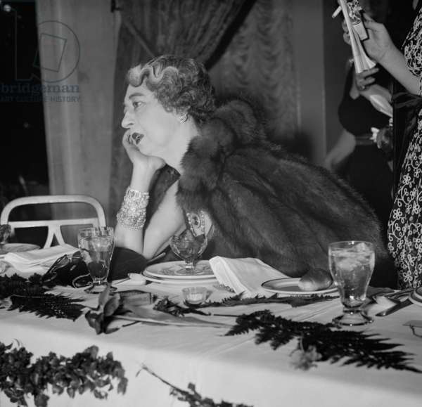 Evalyn McLean wearing her Hope Diamond and an armload of jewels. The wife, Edward Beale McLean, former owner of the Washington Post, was attending a Capital social function, c. 1936. Edward Mclean declared legally insane in October, 1933 committed to a psychiatric hospital, where he stayed until his 1941 death