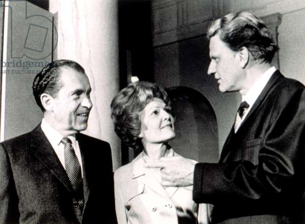 President Richard M. Nixon & First Lady Pat chat with Billy Graham after services in the White House, 3/15/70