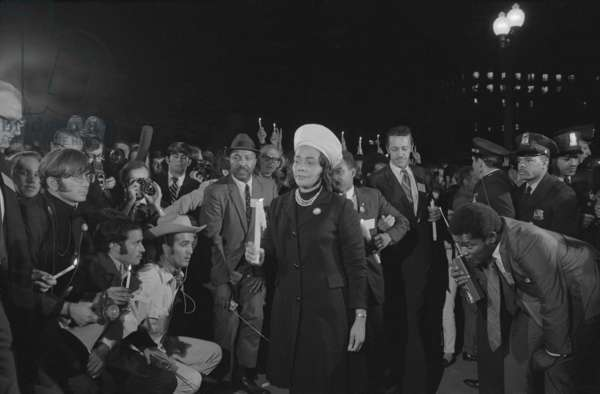 Coretta Scott King at the Moratorium to End the War in Vietnam War, Oct. 15, 1969. Holding a candle, the widow of Martin Luther King, Jr. lead the night march to the White House