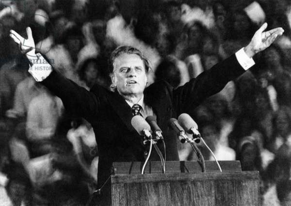 Evangelist, Billy Graham preaches the gospel at the Upper Midwest Crusade, Sain Paul Minnesota, July 13, 1973.