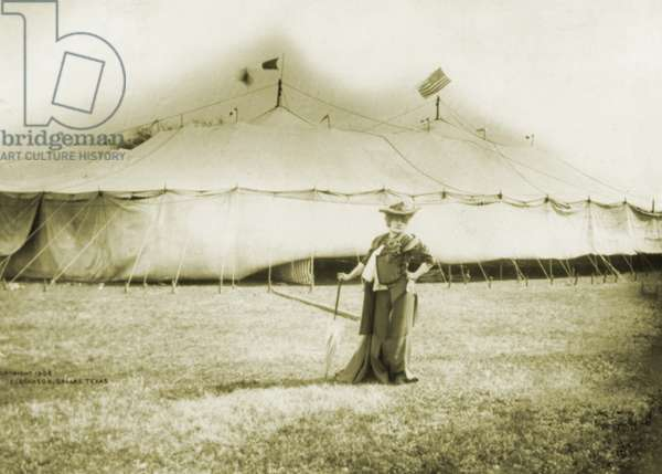 Sarah Bernhardt (1844-1923), French actress, standing in front of the tent of her American tour productions in Dallas, Texas. 1906