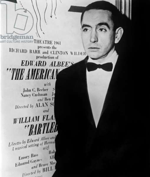 Edward Albee: Edward Albee (b. 1928) American playwright standing beside poster for his play THE AMERICAN DREAM in 1961.