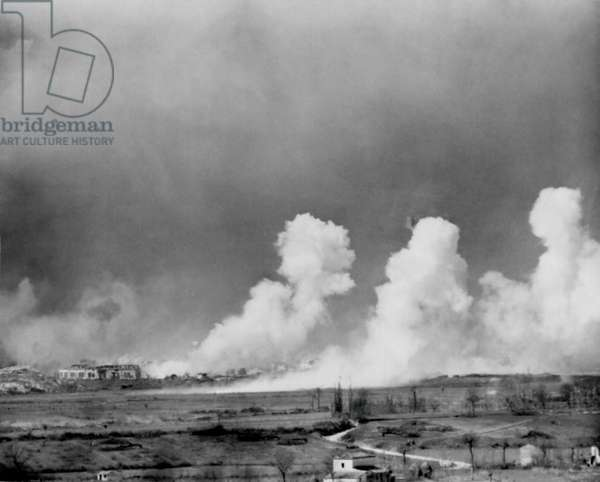 American bombs explode in the town of Cassino, Feb. 15, 1944. The town was completely destroyed but German defenders survived in cellars. The Monte Cassino Abbey was bombed in the same operation. World War 2