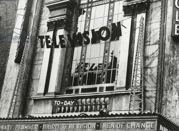 Television was shown for the first time in England, June 1932. The demonstration showed the Epson Derby at the Metropole Cinema. On the theater's marque is 'Baird Television' referring the British television pioneer, John Logie Baird.