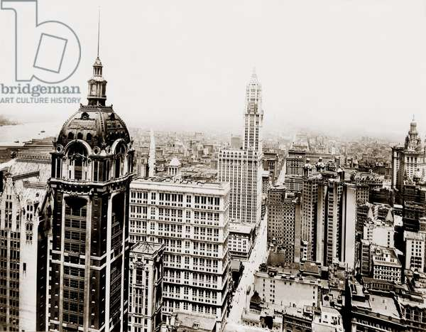 Singer Building (left foreground), 47 stories high, was the world tallest building when built in 1907. In 1913, The Woolworth building, with 55 stories, held the honor until 1930