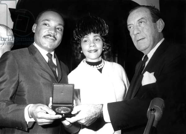 Dr. Martin Luther King Jr., with wife, Coretta Scott King, receiving New York City's Gold Medallion of Honor, from Mayor Robert F. Wagner, New York, NY, January 17, 1964