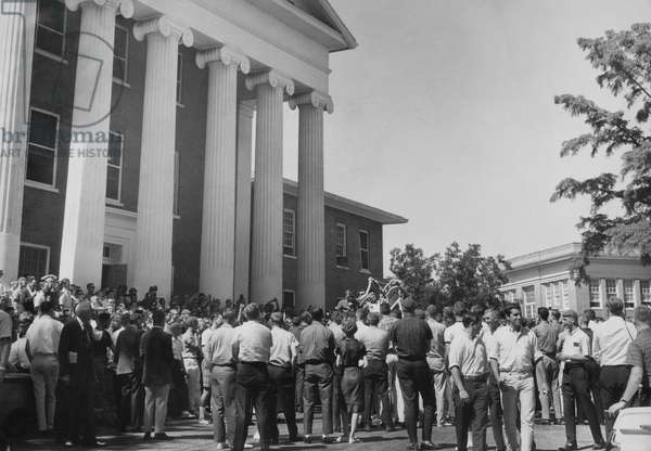 US Civil Rights. A crowd of students gathering outside the Lyceum Building to meet James H. Meredith, as he arrived at the University of Mississippi to register for classes, Oxford, Mississippi, September, 1962