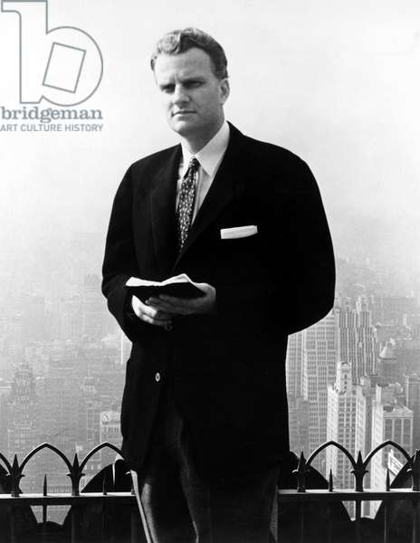 Billy Graham . Evangelist with Bible in publicity for NYC Crusade in Madison Sq.Garden,6/1/57.