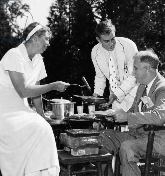 FDR Presdidency. First Lady Eleanor Roosevelt, Franklin Roosevelt Jr., and US President Franklin Delano Roosevelt, at family wiener roast, 1935
