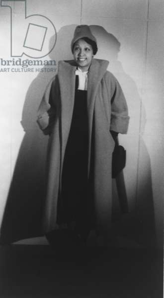Josephine Baker (1906-1975), dressed in a fashionable, but conservative coat, reflecting her post World War II life as a philanthropist and good will ambassador. 1949