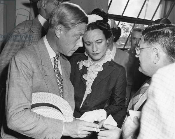 From left: Prince Edward, Duke of Windsor and Duchess of Windsor Wallis Simpson receive their passports from Miami police captain E.W. Melohen upon arriving in Miami, Florida, 1942